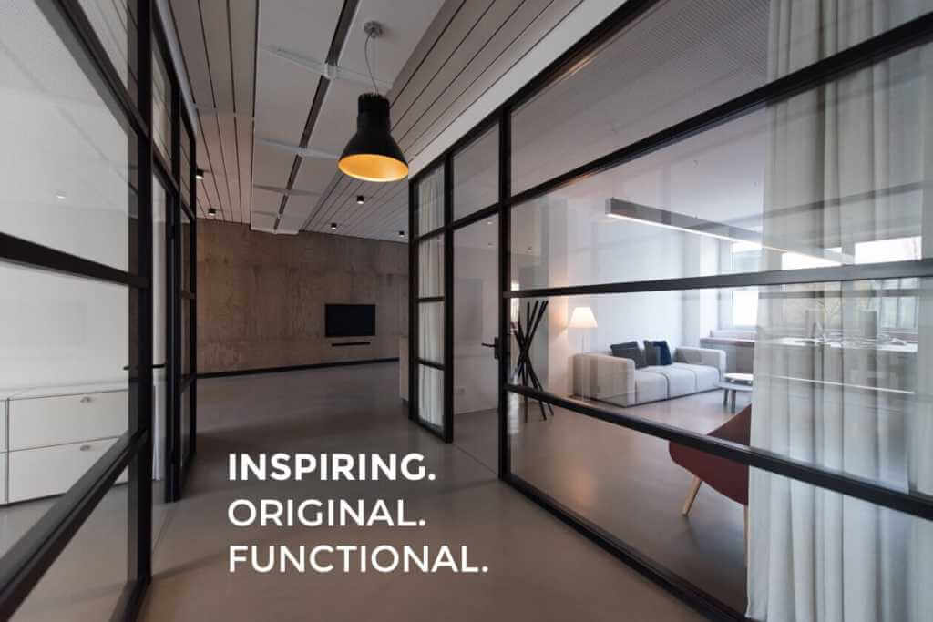 an office design featuring floor-to-ceiling glass walls