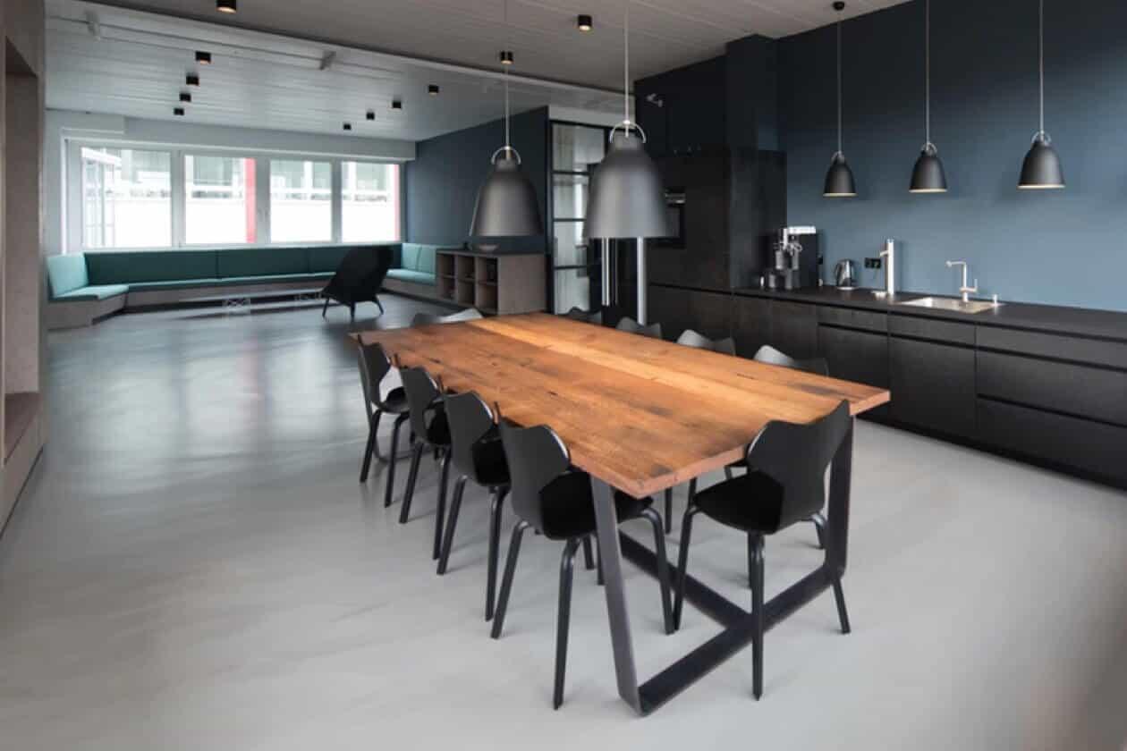 Brown office desk in an open-plan space