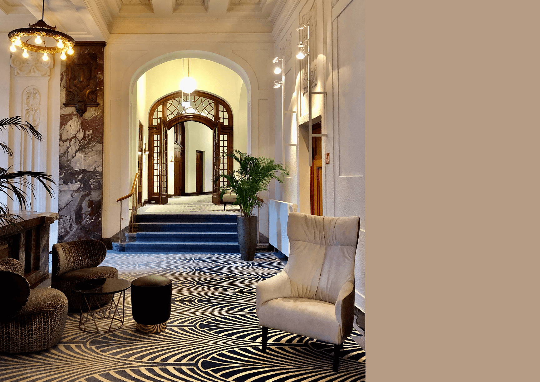 interior design of a hotel hallway with a wooden stained glass arch and marble accent wall